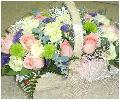 Композиция в корзине из цветов нежных оттенков
